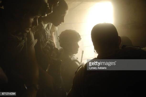 Soldiers with the 173rd division and Afghan workers on the base as thrown back as a mortar fired by the Taliban lands about 20 feet from the opening...