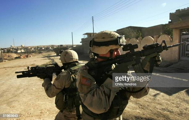 Soldiers with the 1st Battalion 5th Infantry Stryker Brigade Combat Team of the 25th Infantry Division out of Ft Lewis Washington cover each other in...