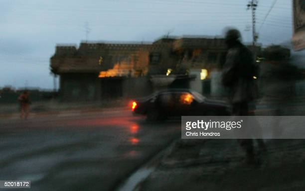 S Soldiers with the 1st Battalion 5th Infantry Stryker Brigade Combat Team of the 25th Infantry Division out of Ft Lewis Washington approach a car...