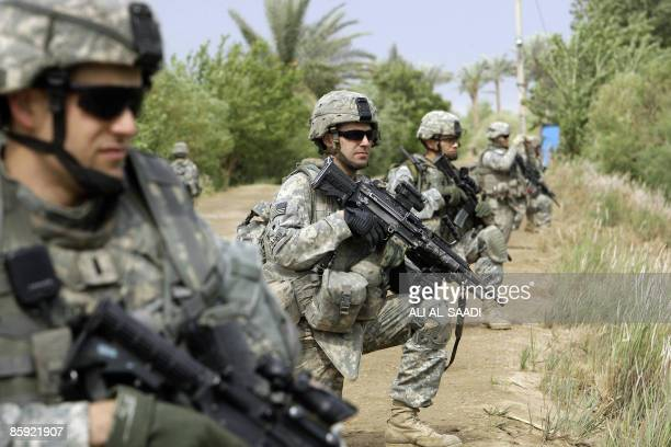 US soldiers with the 1st Battallion 6th Regiment 2nd BCT 1st Armoured Division comb an area in Owesat southwest of Baghdad on April 12 2009 The...