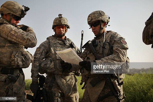S soldiers with the 3rd Armored Cavalry Regiment look at a map while on a patrol on July 17 2011 in Iskandariya Babil Province Iraq As the deadline...
