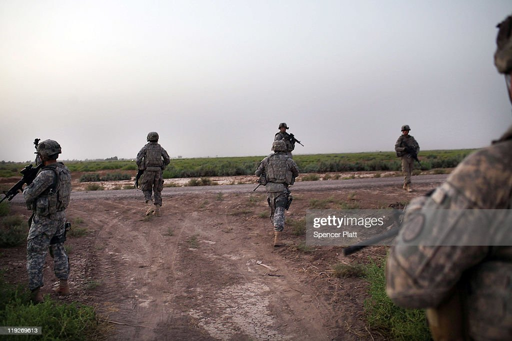 U.S. soldiers with the 3rd Armored Cavalry Regiment participate in a patrol on July 15, 2011 in Iskandariya, Babil Province, Iraq. As the deadline for the departure of the remaining American forces in Iraq approaches, Iraqi politicians have agreed to meet in two weeks time in order to give a final decision about extending the U.S. troops' presence beyond the end of the 2011 deadline. Violence against foreign troops has recently picked-up with June being the worst month in combat-related deaths for the military in Iraq in more than two years. Currently about 46,000 U.S. soldiers remain in Iraq.