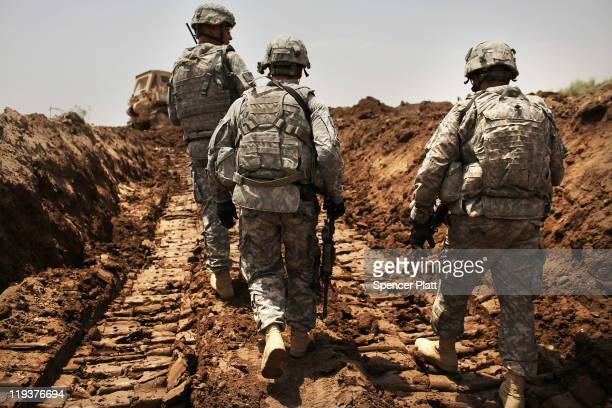 S soldiers with the 3rd Armored Cavalry Regiment patrol a new ditch they have dug to protect the base from attack on July 19 2011 in Iskandariya...
