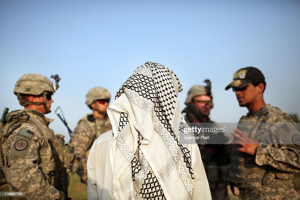 Soldiers with the 3rd Armored Cavalry Regiment speak with a local Iraqi while on a patrol on July 13, 2011 in Iskandariya, Babil Province Iraq. As the deadline for the departure of the remaining American forces in Iraq approaches, Iraqi politicians have agreed to meet in two weeks time in order to give a final decision about extending the U.S. troops' presence beyond the end of the 2011 deadline. Violence against foreign troops has recently picked-up with June being the worst month in combat-related deaths for the military in Iraq in more than two years. Currently about 46,000 U.S. soldiers remain in Iraq.