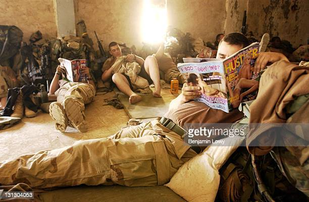Soldiers with the 3rd Battalion of the 1st Brigade of the 101st Airborne Assault Division read several illegal gentlemen's entertainment magazines...