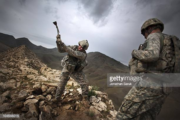 US soldiers with the 3rd Brigade 10th Mountain Division construct an observation post at a new combat outpost May 3 2009 in the Tangi Valley Wardak...