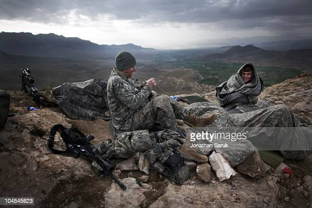 US soldiers with the 3rd Brigade 10th Mountain Division in the early morning at an observation post May 4 2009 in the Tangi Valley Wardak Province...