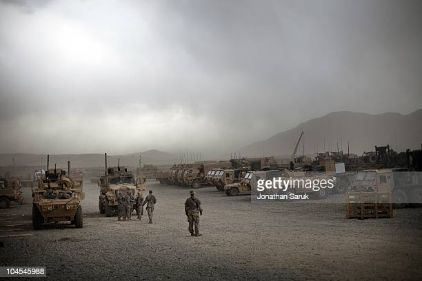 Soldiers with the 3rd Brigade, 10th Mountain Division, prepare for a convoy at a forward operating base May 1, 2009 in Maiden Sharh, Wardak Province,...