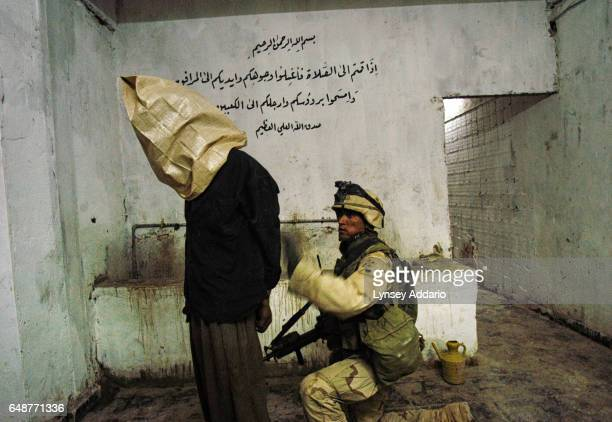 Soldiers with the 4th ID 3rd Brigade from the 1st Battalion68th Armored Regiment detain an Iraqi found on a compound American intelligence indicated...