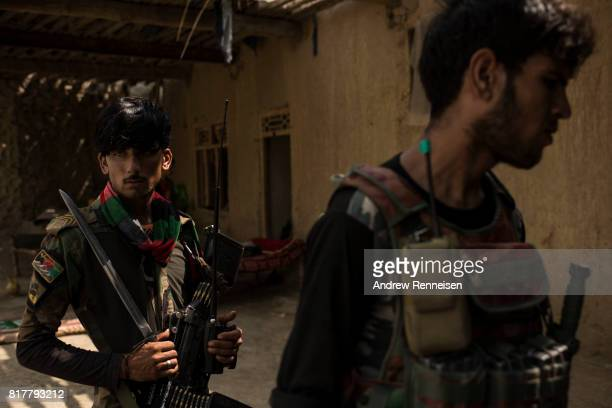 Soldiers with the Afghan National Army at an outpost in the Momand Valley on July 16 2017 in Achin District Afghanistan The building was previously...