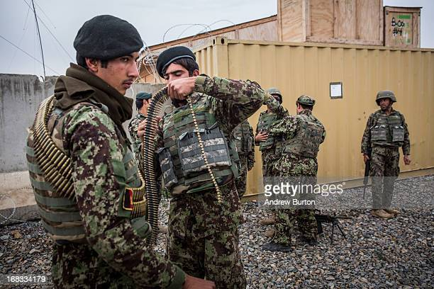 Soldiers with the Afghan National Army prepare for a joint patrol with the United States Army's 3rd Battalion 41st Infantry Regiment near Command...