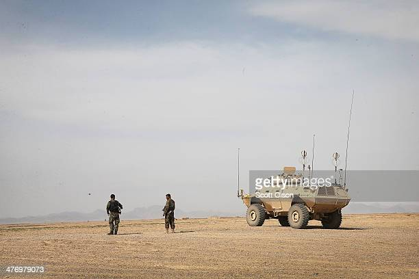 Soldiers with the Afghan National Army prepare to patrol into a village March 5, 2014 near Kandahar, Afghanistan. President Obama recently ordered...