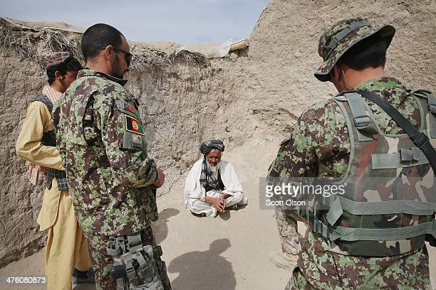 Soldiers with the Afghan National Army question a village elder during a joint patrol with the U.S. Army's 4th squadron 2d Cavalry Regiment on March...