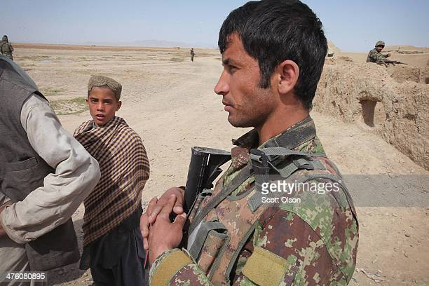 Soldiers with the Afghan National Army question villagers during a joint patrol with the US Army's 4th squadron 2d Cavalry Regiment on March 2 2014...
