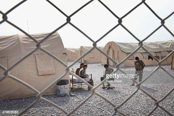 Soldiers with the Afghan National Army sit in their compound on March 4 2014 near Kandahar Afghanistan President Obama recently ordered the Pentagon...