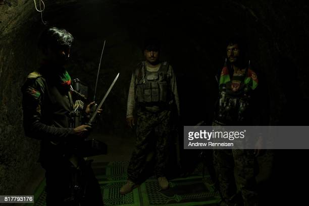 Soldiers with the Afghan National Army stand inside a room which was previously part of a jail used by the Islamic State of Iraq and Syria - Khorasan...