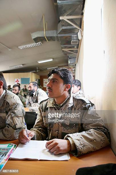 Soldiers with the Afghan National Army take a first aid course during basic training at Forward Operating Base Thunder on March 23 2014 near Gardez...