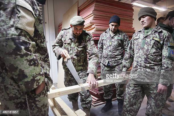 Soldiers with the Afghan National Army's 203rd Corps Engineering Kandak learn construction techniques at Forward Operating Base Thunder on March 23...
