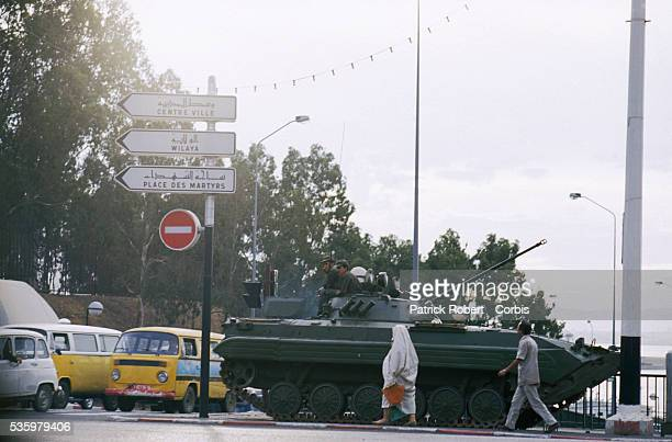 Soldiers with the Algerian armed forces patrol the streets of Algiers in military tanks after riots broke out instigated by rising food prices in a...
