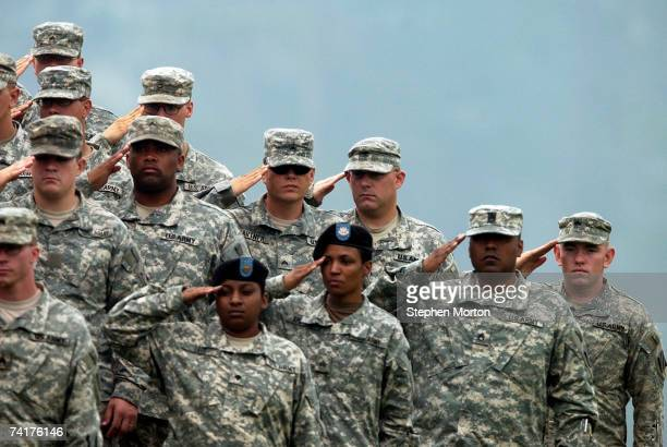 Soldiers with the Army's 3rd Infantry Division salute during a memorial tree dedication ceremony held for five soldiers who recently died in in Iraq...