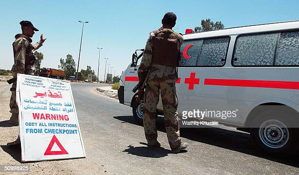 Soldiers with the Iraqi Civil Defence Corp man a checkpoint on the way to the Iraqi city of Baqouba on June 26 2004 near Baqouba Iraq Insurgents...