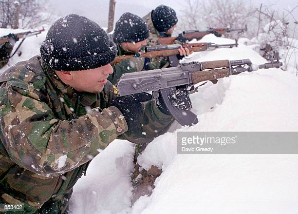Soldiers with the UCPMB or Liberation Army of Presevo Medvedja and Bujanovac guard a front line position February 23 2001 near the ethnic Albanian...