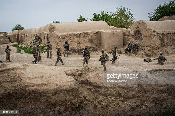 Soldiers with the United States Army's 3rd Battalion 41st Infantry Regiment patrol through a town during a twoday joint mission with the Afghan...