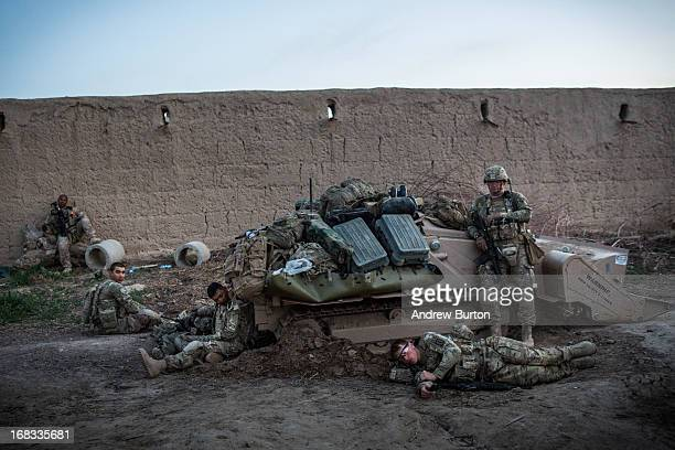 Soldiers with the United States Army's 3rd Battalion 41st Infantry Regiment collapse at the end of the day during a twoday joint mission with the...