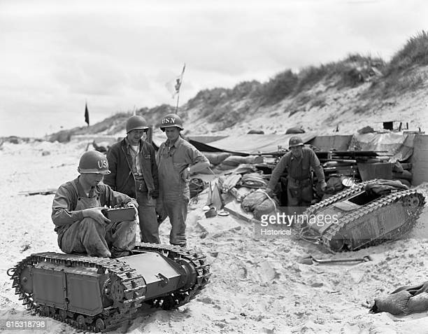 Soldiers with the United States Navy 2nd Beach Battalion inspect radiooperated German Beetle tanks captured on Utah Beach during the Allied DDay...