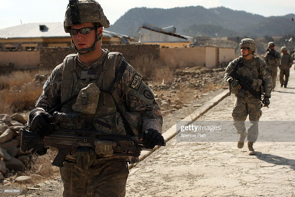 Soldiers with the US Army Able Company, 3-509 Infantry Battalion patrol the main street of Zerak on January 23, 2010 next to their Combat Outpost (COP) in Zerak, Afghanistan. The soldiers went to the town to try and gather information following a rocket and mortar attack on COP Zerak yesterday. COP Zerak, located in Paktika Province, works disrupting and suppressing Taliban routes into Afghanistan from neighboring Pakistan. The province, which is roughly the size of Vermont, shares a restive and porous 600 kilometer border with Pakistan.
