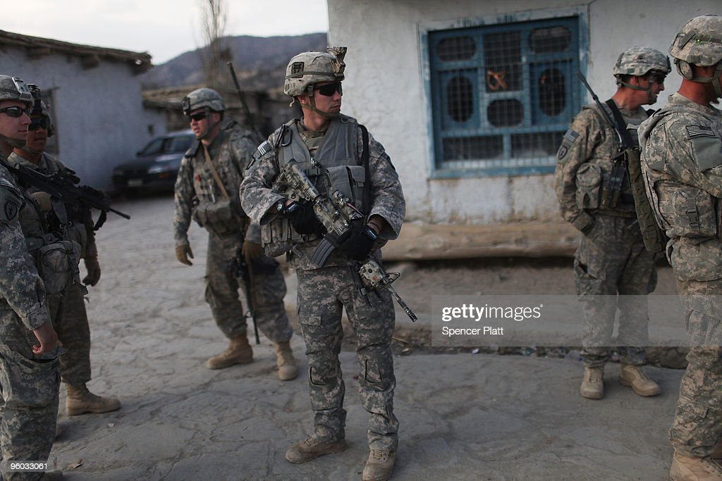 Soldiers with the US Army Able Company, 3-509 Infantry Battalion patrol the main street of Zerak January 23, 2010 next to their Combat Outpost (COP) in Zerak, Afghanistan. The soldiers went to the town to try and gather information following a rocket and mortar attack on COP Zerak yesterday. COP Zerak, located in Paktika Province, works disrupting and suppressing Taliban routes into Afghanistan from neighboring Pakistan. The province, which is roughly the size of Vermont, shares a restive and porous 600 kilometer border with Pakistan.