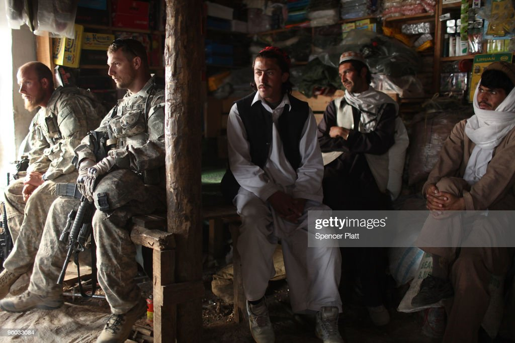 Soldiers with the US Army Able Company, 3-509 Infantry Battalion speak with villagers January 23, 2010 next to their Combat Outpost (COP) in Zerak, Afghanistan. The soldiers went to the town to try and gather information following a rocket and mortar attack on COP Zerak yesterday. COP Zerak, located in Paktika Province, works disrupting and suppressing Taliban routes into Afghanistan from neighboring Pakistan. The province, which is roughly the size of Vermont, shares a restive and porous 600 kilometer border with Pakistan.