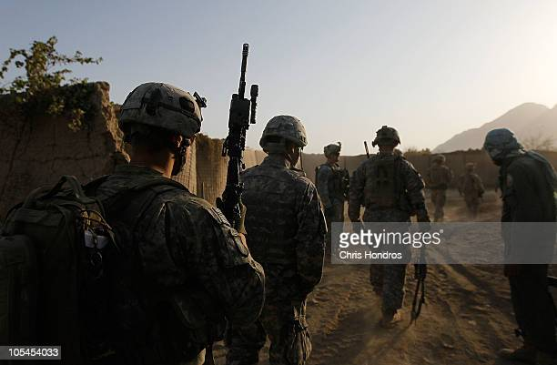 Soldiers with the U.S. Army's 101st Airborne Division head out on an early-morning scouting patrol in an area where their platoon was recently...