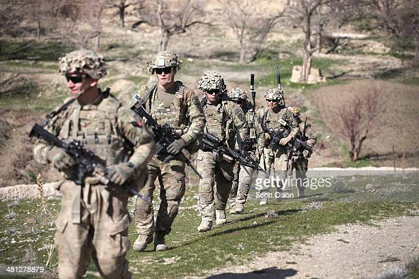 Soldiers with the US Army's 2nd Battalion 87th Infantry Regiment 3rd Brigade Combat Team 10th Mountain Division patrol into a village outside of...