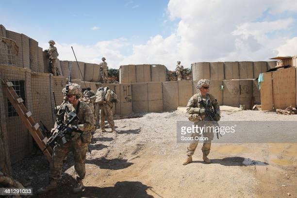 Soldiers with the US Army's 2nd Battalion 87th Infantry Regiment 3rd Brigade Combat Team 10th Mountain Division set up a defensive position inside an...