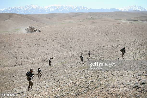 Soldiers with the US Army's 2nd Battalion 87th Infantry Regiment 3rd Brigade Combat Team 10th Mountain Division patrol across barren foothills...