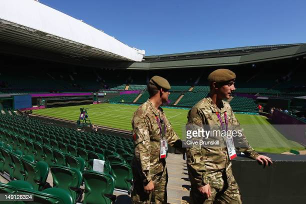 Soldiers work inside Centre Court during previews ahead of the 2012 London Olympic Games at the All England Lawn Tennis and Croquet Club in Wimbledon...