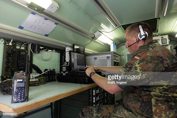 A soldiers works at sat com system at the military training area on May 26 2009 in Luebtheen near Schwerin Germany German armed forces built a camp...
