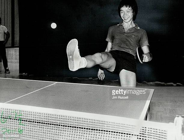 Sole Game Canada's junior table tennis champion Joe Eng displays his shoe reagainst Italy's Rosario Troili Both players the spectors and a few...