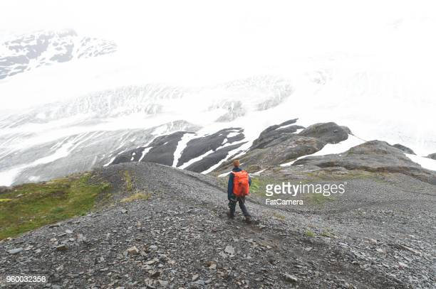 Sole male hikes up a glacier