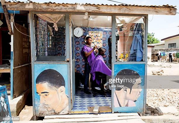 sole trader barbers shop in ghana, africa - ghana africa fotografías e imágenes de stock