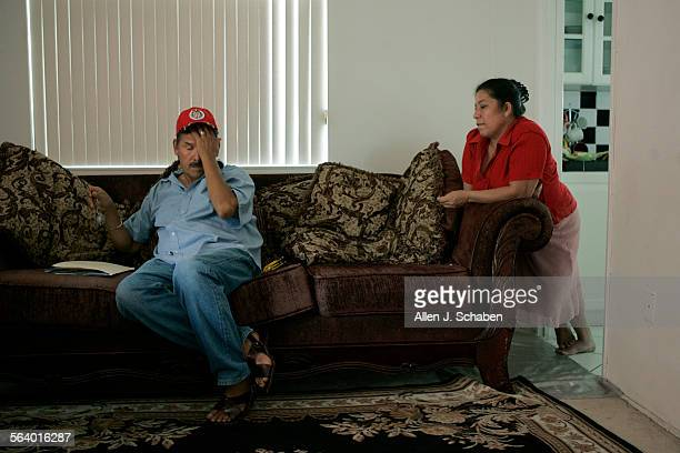 Soledad Aviles 54 left and wife Guadulupe Torres De Aviles shown on the couch where they sleep are losing their family dream home a three–bedroom...