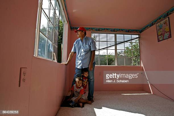 Soledad Aviles 54 shown with grandchildren Isaac Aviles front and Alber Leiva as he looks out the window of an addition that he was renting out to...