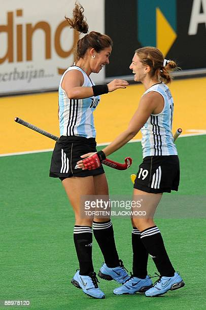 Soledad Garcia of Argentina is congratulated by teammate Marine Russo after scoring the opening goal against China during the first round of the...