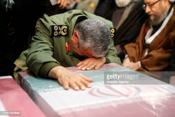 Soleimanis longtime lieutenant and the new leader of Quds Force Gen Esmail Qaani cries over the coffin during the funeral ceremony of Qasem Soleimani...