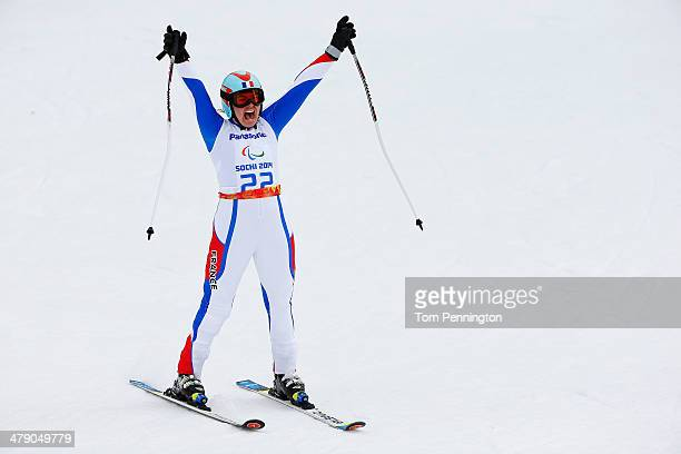 Solene Jambaque of France celebrates in the Women's Giant Slalom Standing during day nine of the Sochi 2014 Paralympic Winter Games at Rosa Khutor...