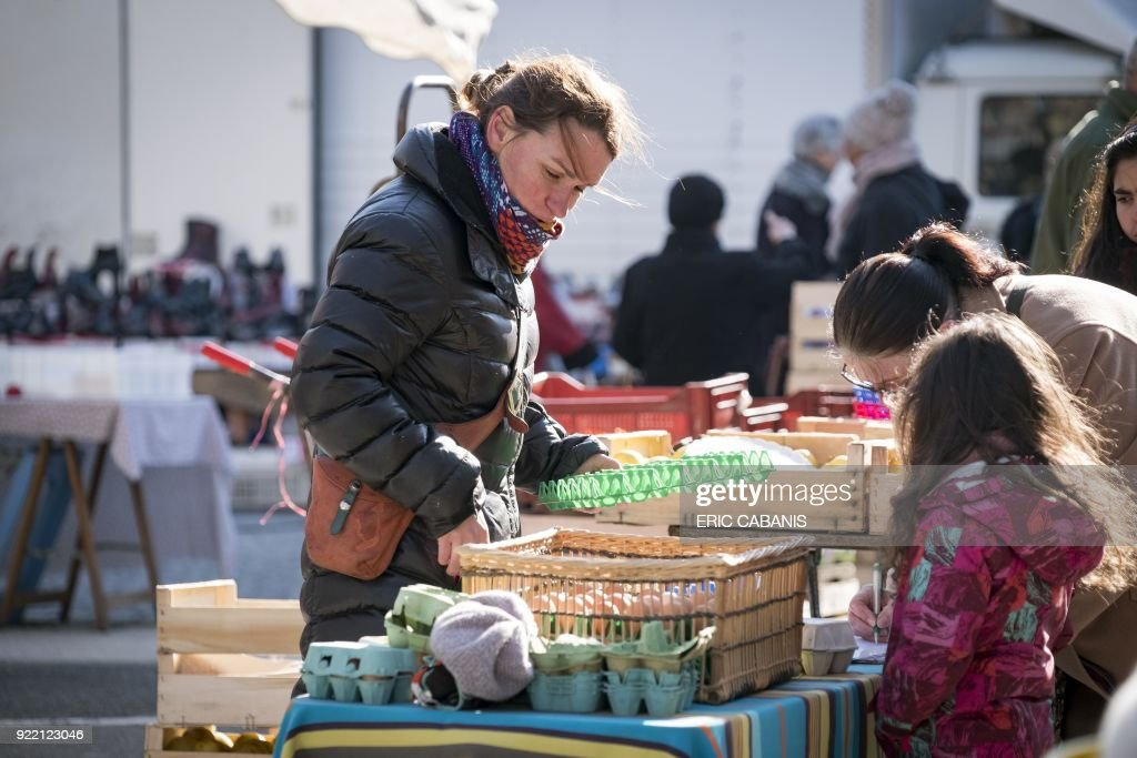 Solenn Guillaume, a young livestock farmer who moved to Fanjeaux (Aude) in the 'natural region' of Piege five years ago with her companion, sells eggs from her farm at a market in Bram on February 20, 2018. The region is considered a 'disadvantaged area', giving it entitlement to substantial aid through the government's 'Compensatory Allowance for Natural Handicap' program (Indemnite compensatoire de handicaps naturels, ICHN). The map of disadvantaged areas is currently being revised and Fanjeaux may be part of the 1,4000 communes removed from the list of disadvantaged areas. /