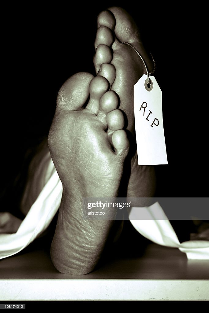 """Soles of Feet with Toe Tag Reading """"RIP"""", Sepia Toned : Stock Photo"""