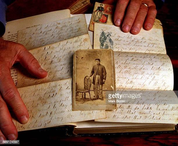 SOLettersBook052099MB–––Dana Point resident Robert Battin holds an original letter written by his grandfather just after the Civil War battle of...