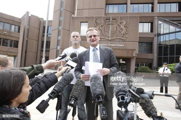 Solicitor Robin Makin read a statement to the media as Ralph Bulger the father of James Bulger looks on outside Liverpool Crown Court as they made a...